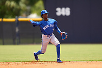 FCL Blue Jays second baseman Marcos De La Rosa (22) throws to first base during a game against the FCL Yankees on June 29, 2021 at the Yankees Minor League Complex in Tampa, Florida.  (Mike Janes/Four Seam Images)