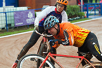 31 AUG 2015 - IPSWICH, GBR - Chris Jukes (front) of Wednesfield falls in front of Jamie Chittock of Ipswich during a heat at the British Cycle Speedway Championships at Whitton Sports and Community Centre in Ipswich, Suffolk, Great Britain (PHOTO COPYRIGHT © 2015 NIGEL FARROW, ALL RIGHTS RESERVED)