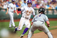 LSU Tigers second baseman Jared Foster (17) slides towards home as TCU Horned Frogs catcher Evan Skoug (9) blocks the plate during the NCAA College World Series on June 14, 2015 at TD Ameritrade Park in Omaha, Nebraska. TCU defeated LSU 10-3. (Andrew Woolley/Four Seam Images)