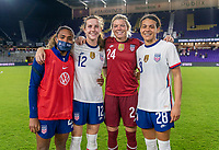 ORLANDO, FL - JANUARY 22: Catarina Macario #29, Tierna Davidson #12, Jane Campbell #24 and Alana Cook #28 of the USWNT pose for a photo after a game between Colombia and USWNT at Exploria stadium on January 22, 2021 in Orlando, Florida.