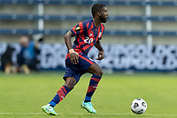 KANSAS CITY, KS - JULY 11: Shaq Moore #20 of the United States moves with the ball during a game between Haiti and USMNT at Children's Mercy Park on July 11, 2021 in Kansas City, Kansas.