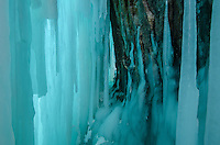 Looking down a narrow path behind the ice curtains of Grand Island. Munising, MI