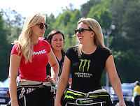 May 17, 2015; Commerce, GA, USA; NHRA top fuel driver Brittany Force (right) with her sister, funny car driver Courtney Force during the Southern Nationals at Atlanta Dragway. Mandatory Credit: Mark J. Rebilas-USA TODAY Sports