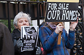 Housing campaigners protest outside an auction by Savills estate agents of pubic sector homes at the London Mayfair Marriott hotel.