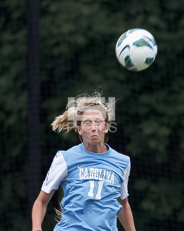 University of North Carolina midfielder Kelly McFarlane (11) heads the ball.   University of North Carolina (blue) defeated Boston College (white), 1-0, at Newton Campus Field, on October 13, 2013.