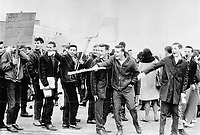 1966 FILE - <br /> Chelmsford Students jeer as Cars Cross Picket Line at Struck School; School board has now applied for a ban on all picketing; as 200 join 14 strikers near Sudbury<br /> <br /> <br /> 1966<br /> <br /> PHOTO :  Gordon McCaffrey - Toronto Star Archives - AQP