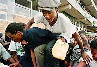 People flood into the First National Bank (FNB) Stadium in Soweto for a rally after Nelson Mandela's release from prison.