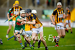 Abbeydorney's Ronan O'Donavan tries to clear his defence under pressure from Crotta's James Sheehan during their encounter in the round 2 game of the County Senior hurling championship