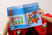 Pictured: Alice Morgan's children with a Learn Welsh book. Friday 09 June 2017<br /> Re: Alice Morgan (NOT HER REAL NAME) who has spoken about her experience sending her children to Llangennech Primary School in Carmarthenshire Wales, which will be turned into a Welsh only language medium from a bilingual one.