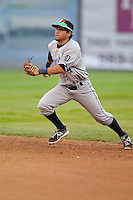 Second baseman Jose Zambrano # 4 of the West Michigan Whitecaps charges ground ball against the Clinton LumberKings at Ashford University Field on July  25, 2014 in Clinton, Iowa. The Whitecaps won 9-0.   (Dennis Hubbard/Four Seam Images)