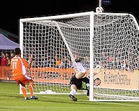 Daniel Paladini #11 Of the Carolina Railhawks has his header tipped over by William Gaudette #1 of the Puerto Rico Islanders during the second leg of the USSF-D2 championship match at WakeMed Soccer Park, in Cary, North Carolina on October 30 2010. The game ended 1-1, Puerto Rico won on overall goals 3-1.