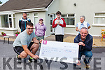 Damien Murphy presenting a cheque to Adrian Griffin(Chairman Cunamh Iveragh) money raised from his 333Km walk, this will go toward the Respite Extension Development, picturd back l-r; Brendan Murphy(Sec Cunamh Iveragh), Aoife Murphy, John Cahill & Cindy Browne.