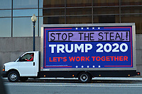 """Washington, DC - November 14, 2020: A mobile billboard drives near downtown Washington, DC November 14, 2020 during the """"Stop The Steal"""" rally in support of President Donald Trump.  (Photo by Don Baxter/Media Images International)"""