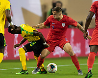 NASHVILLE, TN - JULY 3: Junior Flemmings #12 and Jordan Morris #11 challenge for the ball during a game between Jamaica and USMNT at Nissan Stadium on July 3, 2019 in Nashville, Tennessee.