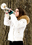 WINSTED, CT-121617JS08---Briana Hall plays taps at the end of the Wreaths Across America ceremony Saturday at Forest View Cemetery in Winsted. The event was hosted by the Brooks-Green Woods Chapter of the National Society Daughters of the American Revolution.  Hall, is a graduate of the Gilbert School in Winsted. <br /> Jim Shannon Republican-American
