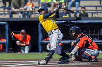 Michigan Wolverines second baseman Ako Thomas (4) swings the bat against the Illinois Fighting Illini during the NCAA baseball game on April 8, 2017 at Ray Fisher Stadium in Ann Arbor, Michigan. Michigan defeated Illinois 7-0. (Andrew Woolley/Four Seam Images)