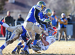 Bishop Gorman's Jonathan Shumaker gets tackled by a wave of Reed defenders in an NIAA Division I playoff game at Reed High School in Sparks, Nev., on Saturday, Nov. 28, 2015. Bishop Gorman won 41-13. (Cathleen Allison/Las Vegas Review-Journal)