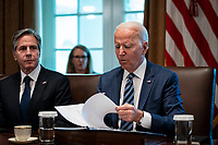 United States President Joe Biden looks over his notes as US Secretary of State Antony Blinken, listens  during a cabinet meeting at the White House in Washington, D.C., U.S., on Tuesday, July 20, 2021. Biden administration officials say they're starting to see signs of relief for the global semiconductor supply shortage, including commitments from manufacturers to make more automotive-grade chips for car companies. <br /> CAP/MPI/RS<br /> ©RS/MPI/Capital Pictures