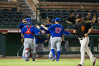 AZL Cubs relief pitcher Faustino Carrera (97) receives a high five from catcher Marcus Mastrobuoni (5) as he walks to the dugout between innings during Game Three of the Arizona League Championship Series against the AZL Giants on September 7, 2017 at Scottsdale Stadium in Scottsdale, Arizona. AZL Cubs defeated the AZL Giants 13-3 to win the series two games to one. (Zachary Lucy/Four Seam Images)