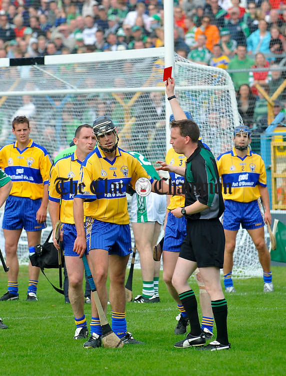 Referee Eamonn Morris sends off Clare's Brendan Bugler in the closing stages of teh game against Limerick in Thurles. Photograph by John Kelly.