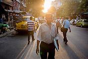 Pedestrians walk along a street in Kolkata, West Bengal, India on May 25, 2017. Photographer: Sanjit Das