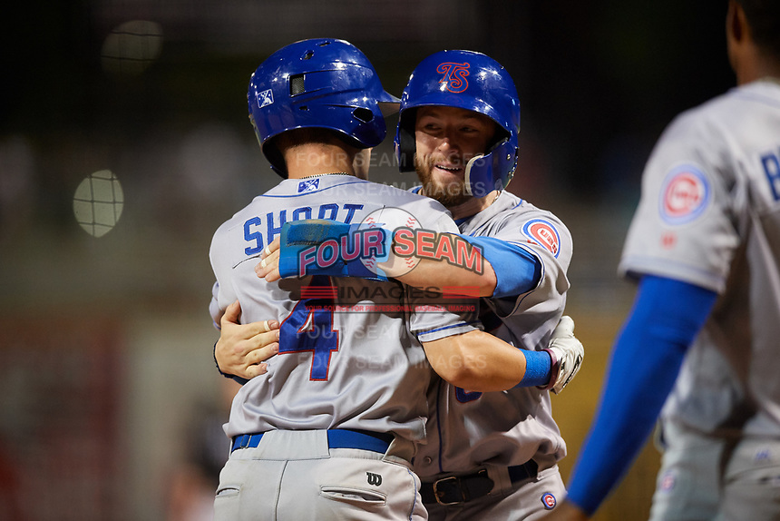 Tennessee Smokies shortstop Zack Short (4) is hugged by Trent Giambrone (6) after hitting a home run in the top of the fourth inning during a game against the Birmingham Barons on August 16, 2018 at Regions FIeld in Birmingham, Alabama.  Tennessee defeated Birmingham 11-1.  (Mike Janes/Four Seam Images)