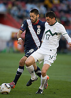 The USA's Clint Dempsey fights for a loose ball with Slovenia's Andraz Kirm during the 2010 World Cup match between USA and Slovenia at Ellis Park Stadium in Johannesburg, South Africa on Friday, June 18, 2010.  The USA tied Slovenia 2-2.