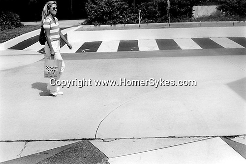 .Girl is striped shirt and carrier bag out shopping. South Beach Miami Florida USA. 1999