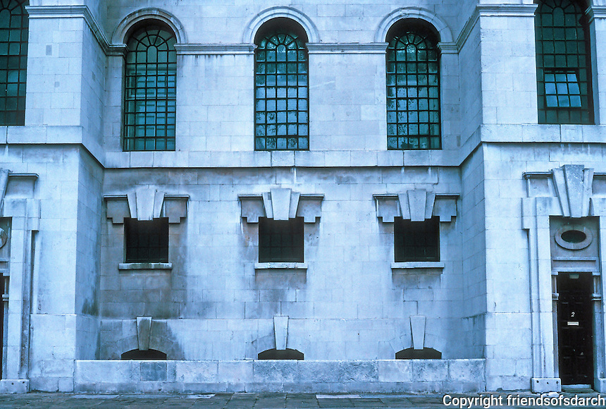 """Nicholas Hawksmoor: St. George-in-the-East, South Elevation. """"The famous keystoned doorways to the stair towers."""" (V 8,368)  Photo '90."""