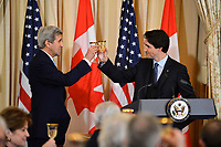Canadian Prime Minister Justin Trudeau and U.S. Secretary of State John Kerry toast the U.S.-Canada relationship at a State Luncheon in honor of the Canadian Prime Minister and his wife at the U.S. Department of State in Washington, D.C., on March 10, 2016. [State Department photo/ Public Domain]