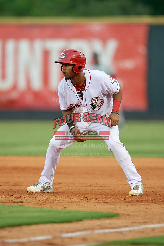 Greeneville Reds left fielder Reniel Ozuna (27) leads off first base during a game against the Pulaski Yankees on July 27, 2018 at Pioneer Park in Tusculum, Tennessee.  Greeneville defeated Pulaski 3-2.  (Mike Janes/Four Seam Images)