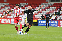 Danny Newton of Stevenage F.C. just get the ball a head of Darron Gibson of Salford City F.C. during Stevenage vs Salford City, Sky Bet EFL League 2 Football at the Lamex Stadium on 3rd October 2020