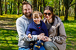 Little Aidan Cook with dad and mom Philip and Joanne Cook enjoying a stroll around Muckross Gardens on Thursday