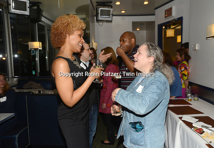 Ashley and Leah at the  People Magazine Employees Reunion on April 26, 2013 at Burger Heaven at 804  Lexington Avenue in New York City.