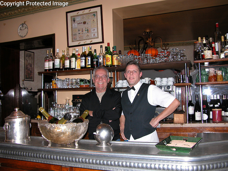 "Guy and his long time waiter at his neighborhood brasserie, ""La Poule au Pot"" in the 7th Arrondissement of Paris"