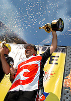 Jul. 21, 2013; Morrison, CO, USA: NHRA funny car driver Cruz Pedregon celebrates in the winner's circle after winning the Mile High Nationals at Bandimere Speedway. Mandatory Credit: Mark J. Rebilas-