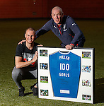 Kenny Miller gers presented with a special framed shirt by Mark Warburton for scoring 100 goals for Rangers