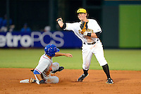Bradenton Marauders infielder Dan Gamache #10 attempts to turn a double play as T.J. Rivera #2 slides in during a game against the St. Lucie Mets on April 12, 2013 at McKechnie Field in Bradenton, Florida.  St. Lucie defeated Bradenton 6-5 in 12 innings.  (Mike Janes/Four Seam Images)