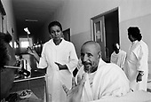 """Asmara, Eritrea.November 2002.Birhan Aim Hospital  (Light to the Eye Hospital)..A delighted Coptic Priest sees light for the first time through what was a cataract blind eye and proclaims that the doctor has, """"the hands of Christ?."""