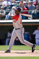 Brandon Jones #28 of the Gwinnett Braves follows through on his swing versus the Charlotte Knights at Knights Castle April 9, 2009 in Fort Mill, South Carolina. (Photo by Brian Westerholt / Four Seam Images)