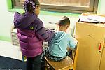 Education Preschool 4 year olds girl putting hand on shoulder of sad boy to comfort him