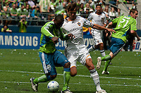 Jhon Hurtado of the Seattle Sounders fights with Josh Tudela of the LA Galaxy at Quest Field on May 10, 2009. The Sounders and Galaxy played to a 1-1 draw.