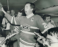 1979 FILE PHOTO - ARCHIVES -<br /> <br /> Clark; Joe (election campaign 1979) : <br /> <br /> Happy hour on Tory plane as Joe Clark leads a sing-song <br /> while wearing a Montreal hockey team jersey<br /> <br /> Bezant, Graham<br /> Picture, 1979<br /> <br /> 1979,<br /> <br /> PHOTO : Graham Bezant - Toronto Star Archives - AQP