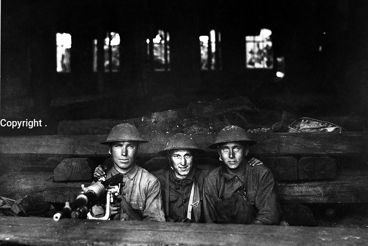 Machine gun set up in railroad shop.  Company A,  Ninth Machine Gun Battalion.  Chateau Thierry, France.  June 7, 1918. Pvt. J. E. Gibbon.  (Army)<br /> NARA FILE #:  111-SC-14654<br /> WAR & CONFLICT BOOK #:  632