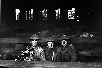 Machine gun set up in railroad shop.  Company A,  Ninth Machine Gun Battalion.  Chateau Thierry, France.  June 7, 1918. Pvt. J. E. Gibbon.  (Army)<br /> NARA FILE #:  111-SC-14654<br /> WAR & CONFLICT BOOK #:  632