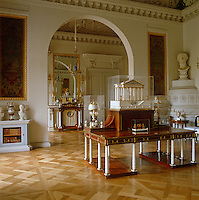 """In the Library of Paul I the imposing desk rests on twelve ivory legs in the shape of slender columns. An ivory and amber model of the """"Temple of Vesta"""" forms the centrepiece"""