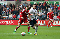 Pictured L-R: Lloyd Isgrove of Wales against Michael Keane of England.  Monday 19 May 2014<br />