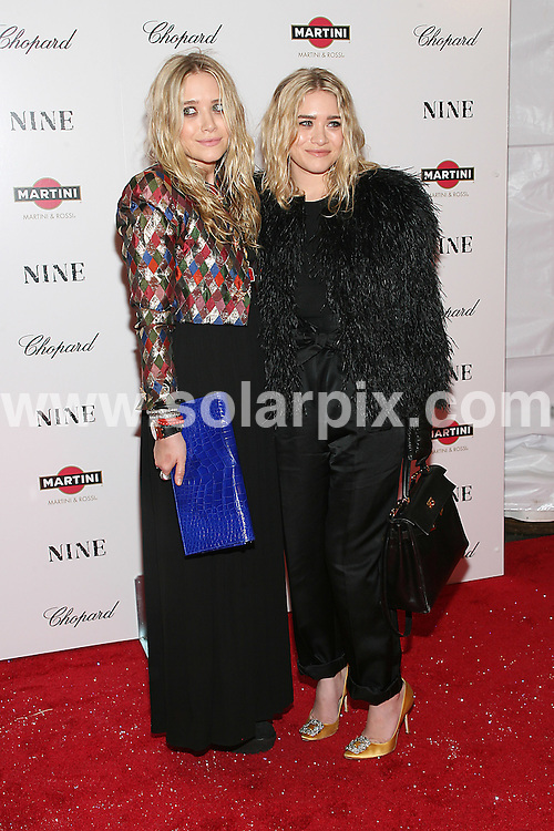 **ALL ROUND PICTURES FROM SOLARPIX.COM**.**SYNDICATION RIGHTS FOR UK, AUSTRALIA, DENMARK, PORTUGAL, S. AFRICA, SPAIN & DUBAI (U.A.E) ONLY**.arrivals for Nine, the New York Premiere at the Ziegfeld Theater, New York City, NY, USA. 15 December 2009..This pic: Mary-Kate Olsen and Ashley Olsen..JOB REF: 10413 PHZ Mayer  DATE: 15_12_2009.**MUST CREDIT SOLARPIX.COM OR DOUBLE FEE WILL BE CHARGED**.**MUST NOTIFY SOLARPIX OF ONLINE USAGE**.**CALL US ON: +34 952 811 768 or LOW RATE FROM UK 0844 617 7637**