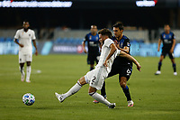 SAN JOSE, CA - SEPTEMBER 5: Keegan Rosenberry #2 of the Colorado Rapids passes the ball under pressure from Shea Salinas during a game between Colorado Rapids and San Jose Earthquakes at Earthquakes Stadium on September 5, 2020 in San Jose, California.