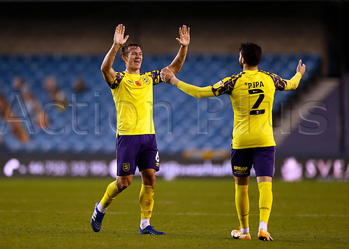 31st October 2020; The Den, Bermondsey, London, England; English Championship Football, Millwall Football Club versus Huddersfield Town; Pipa ( Gonzalo Ávila Gordón) of Huddersfield Town celebrates with Jonathan Hogg of Huddersfield Town after scoring his sides 2nd goal in the 88th minute to make it 0-2